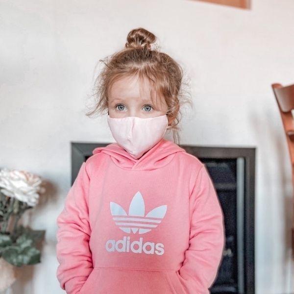 Daisy wearing extra small kids mask
