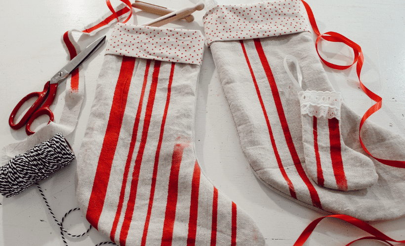 MAKYLA CREATES SUBSCRIBER LIBRARY handmade christmas stockings laying on white sewing table