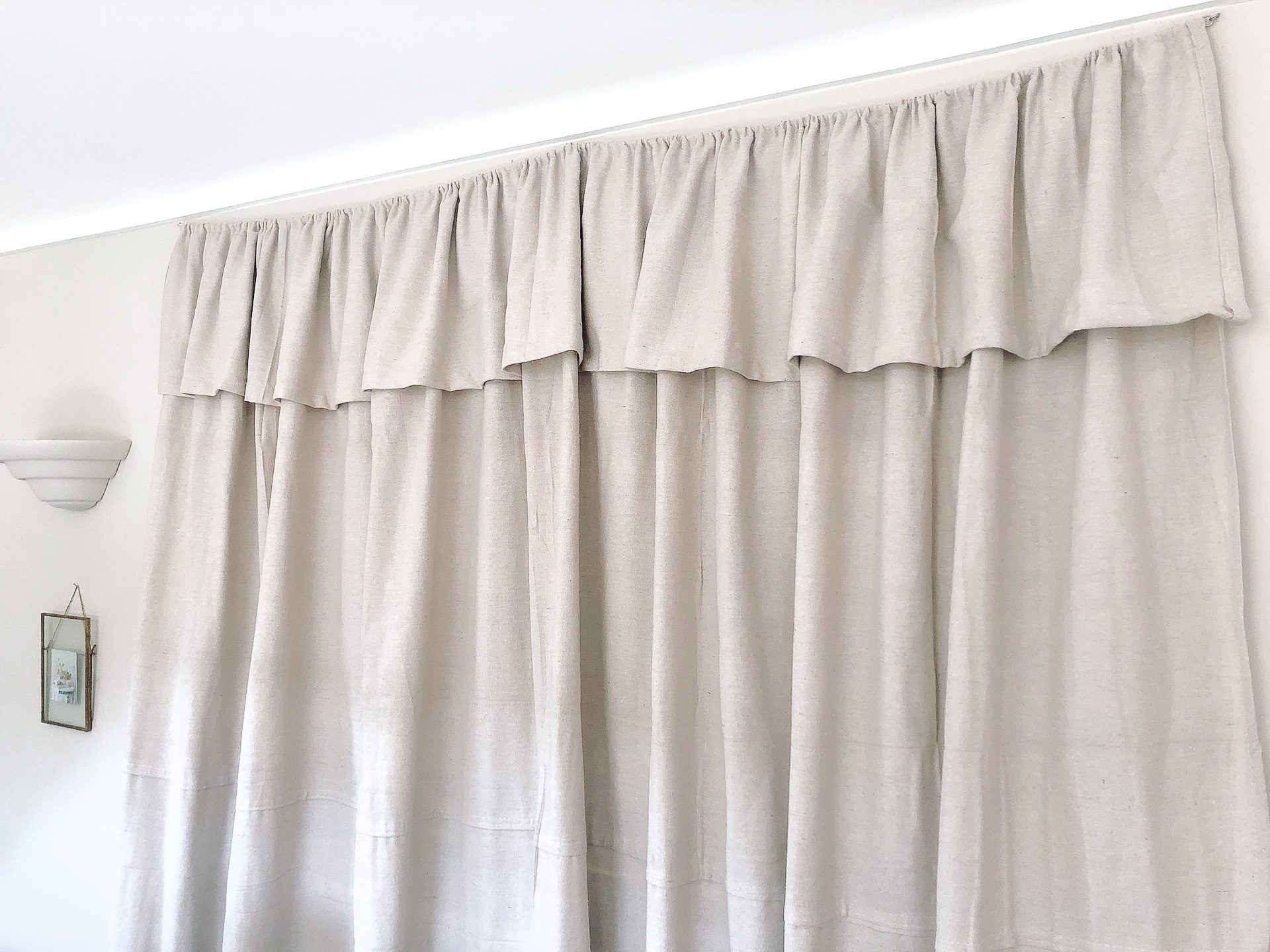 Farmhouse Inspired Curtains Hanging On Wall