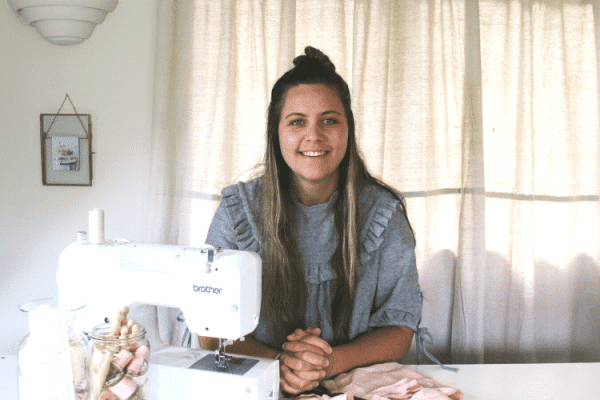 makyla sitting at sewing machine in her sewing room