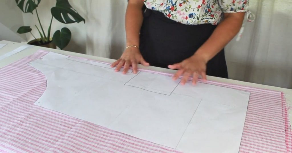 how to make an apron step by step laying out pattern pieces on the fold and cutting out