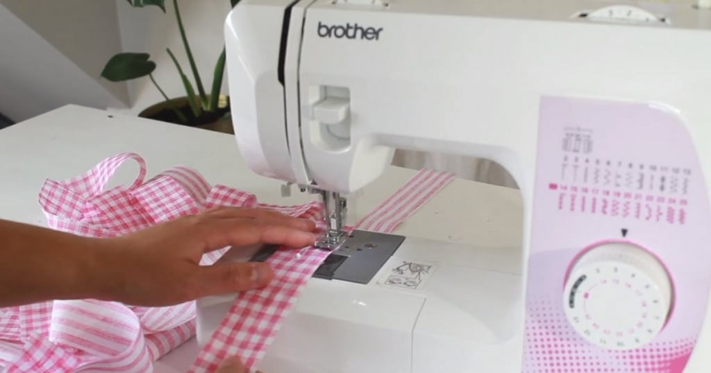 sewing around the makyla sewing around the ties on her brother sewing machine.