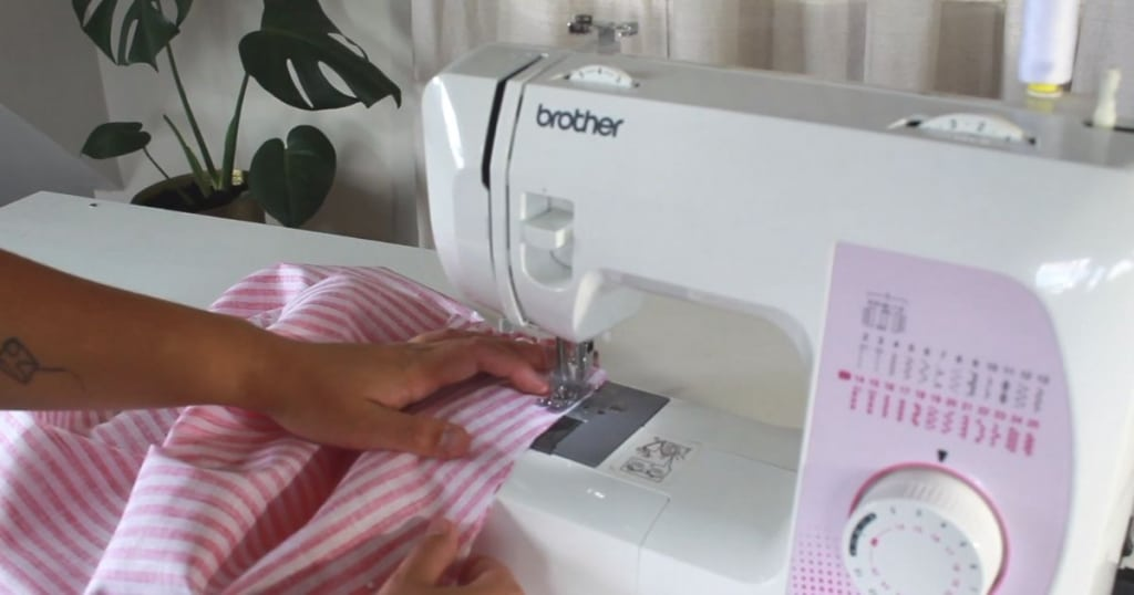 sewing around the outside of apron to close it up.