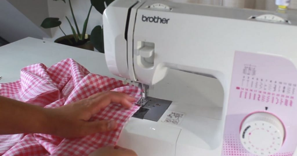 sewing up the opening on the hem apron with an edge stitch