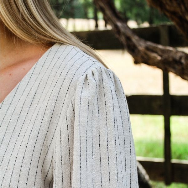 Camille top made in cream/black stripe linen with longsleeve showing gathering at the sleeve shoulders.