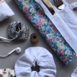 flat lay of scrap fabric sewing project ideas. Head phone case, cutlery holder, scrunchies, wheat bags and pin cushions