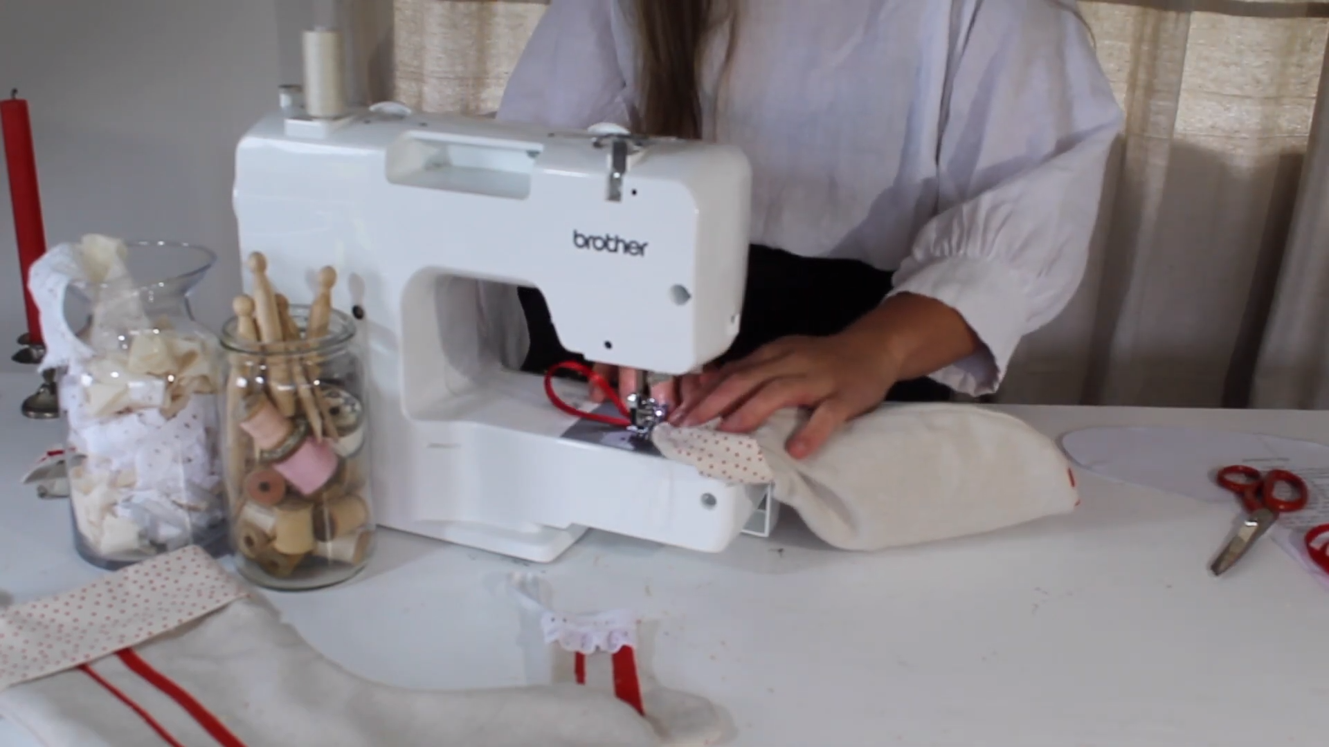 sewing on the ribbon