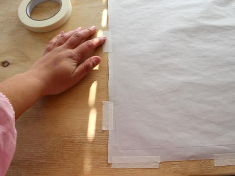 how to cut out delicate fabrics taping paper to the table