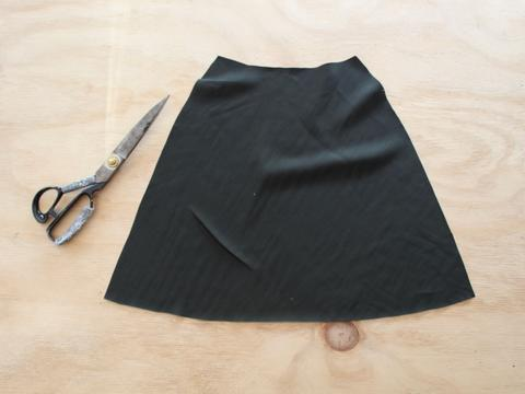 how to cut out delicate fabrics on the bias miniture skirt cut out and laying on the cutting table