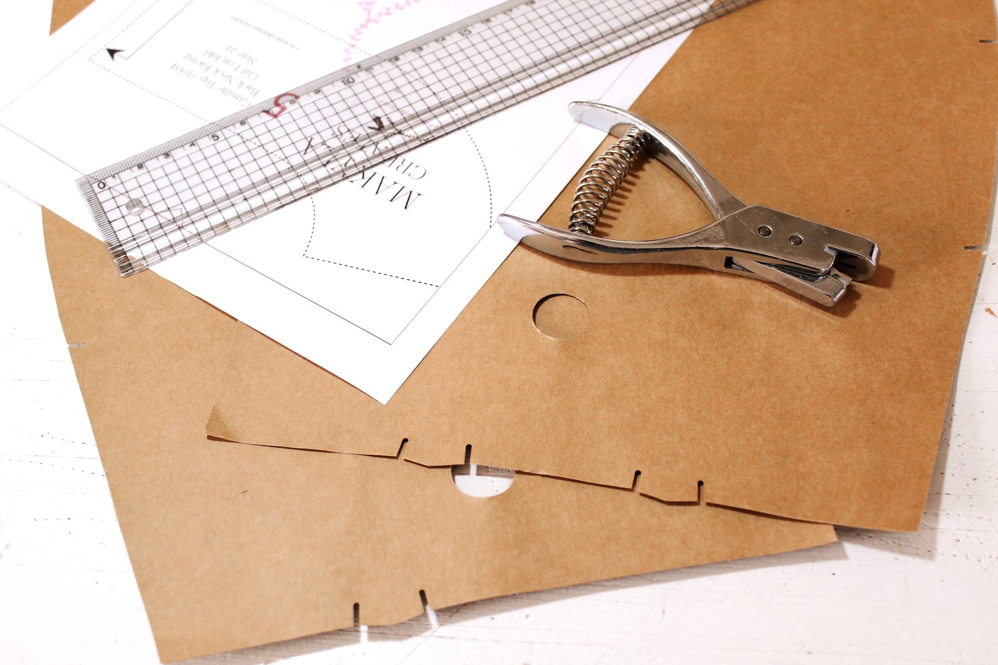 5 sewing tips for beginners patterns laying on table with pattern notcher