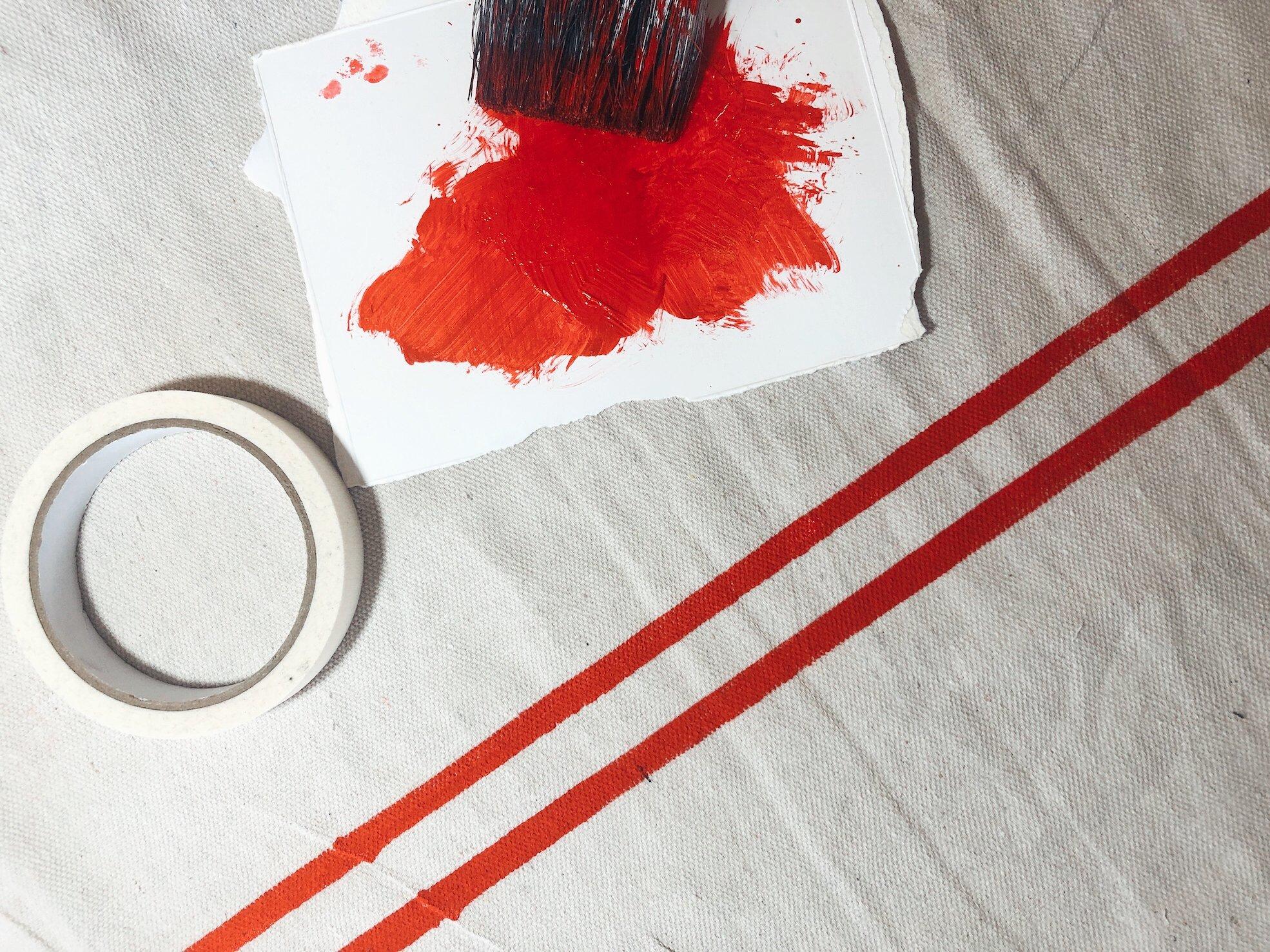 pulling off masking tape on grain sack